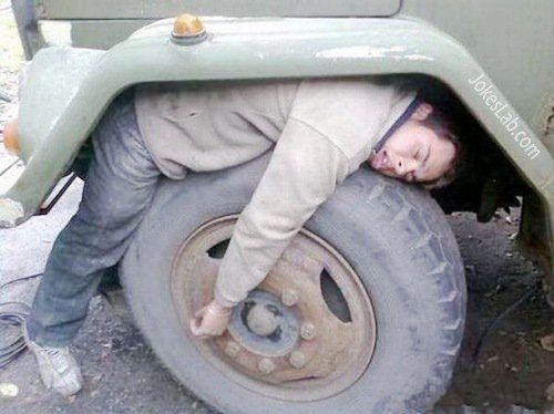 funny-drink-and-sleep-on-car-wheel