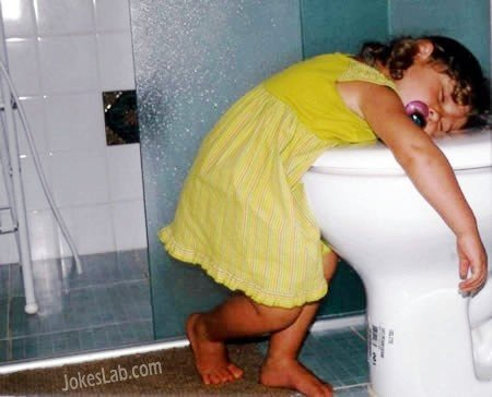 Funny kid sleep in the toilet