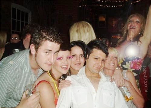Funny boob bulb in group photo