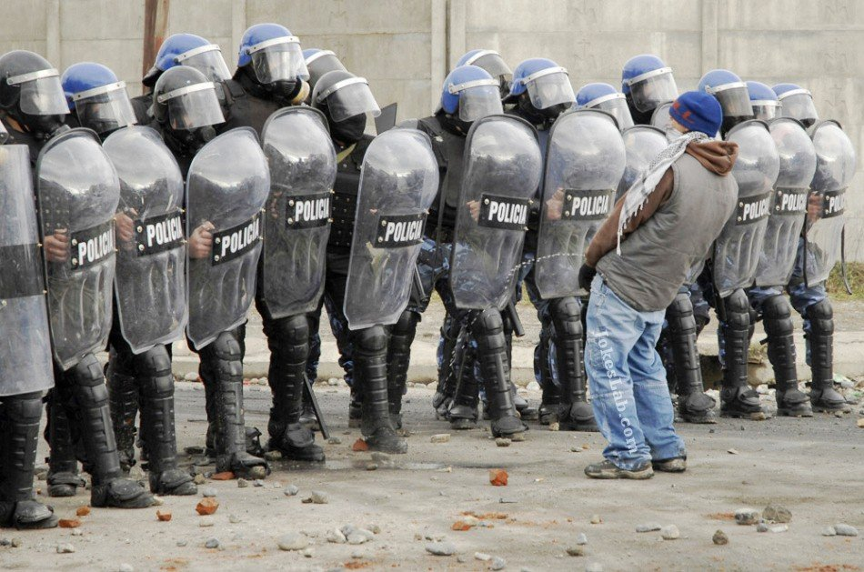 Funny protester: peeing on riot police