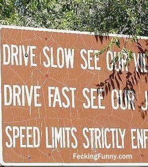 Funny road sign: drive slowly