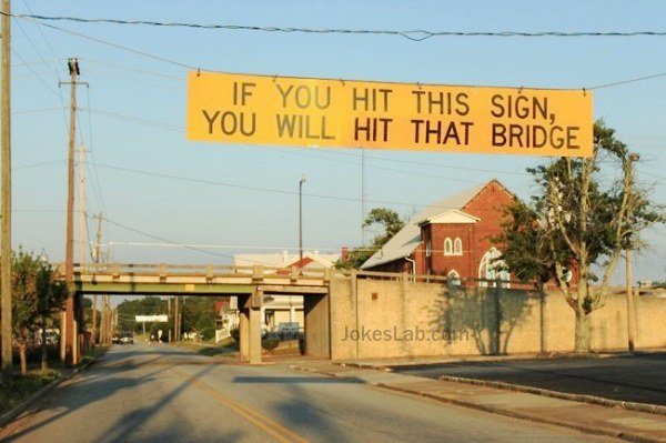 Funny road sign, you will hit the bridge ahead if you hit this sign