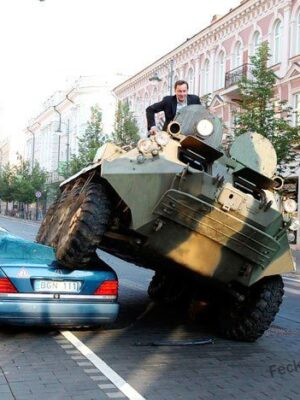 Crazy man driving tank to office