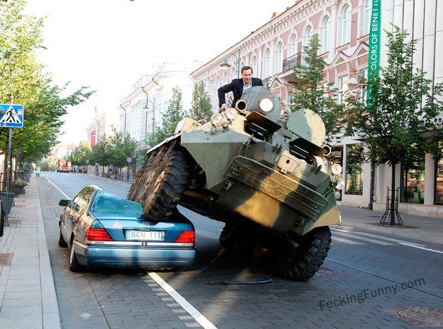 crazy--man-driving-tank-to-office-smasing-a-car