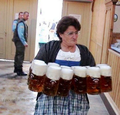 woman-holding-12-beer-jugs