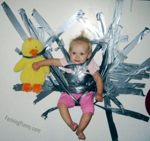 Bad parenting: hold the baby on wall with tapes