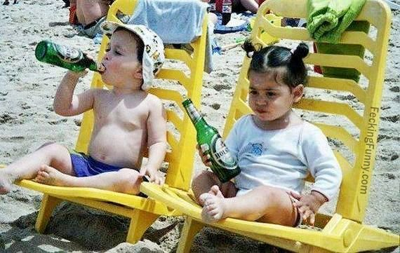 Bad education: kids drinking beer in beach