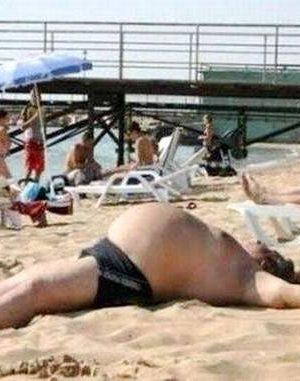 Big, fat belly in beach