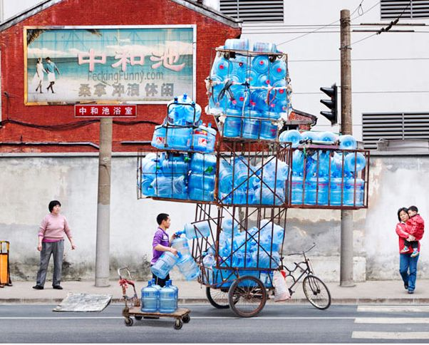 Chinese artist: balacing the water bottles