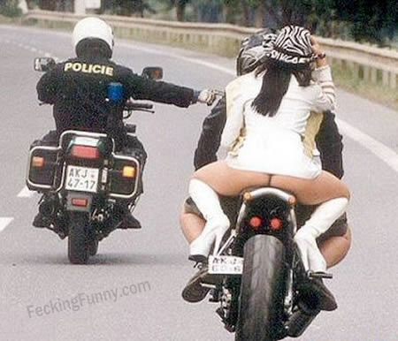 Funny policeman: nudity is not allowed on motorbikes