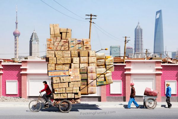 Overloaded tricycle witrh boxes in Shanghai