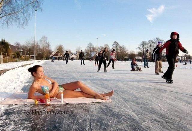 sexy-girl-enjoying-sun-bath-on-snow
