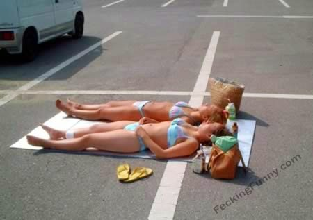 Sexy blondes enjoying sunbath in car park