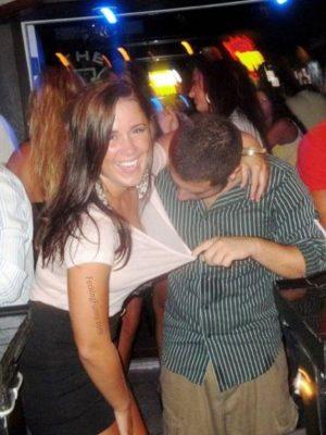 Crazy guy checking girl's breast
