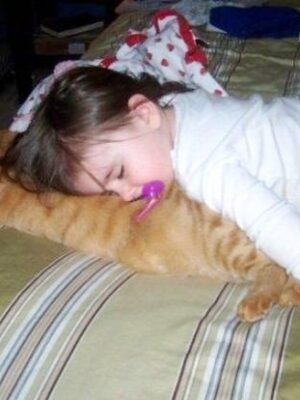 Girl sleeping with a cat