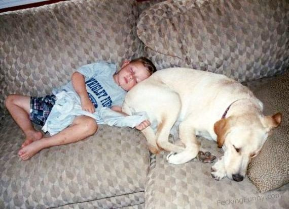 Boy sleeping with dog