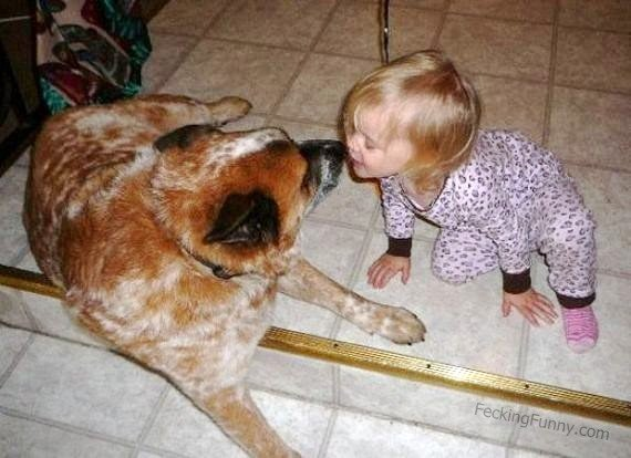 Girl kissing with……dog