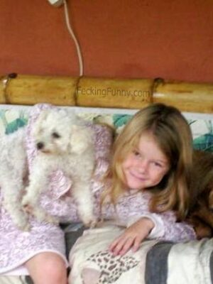 Girl sleeping with two dogs