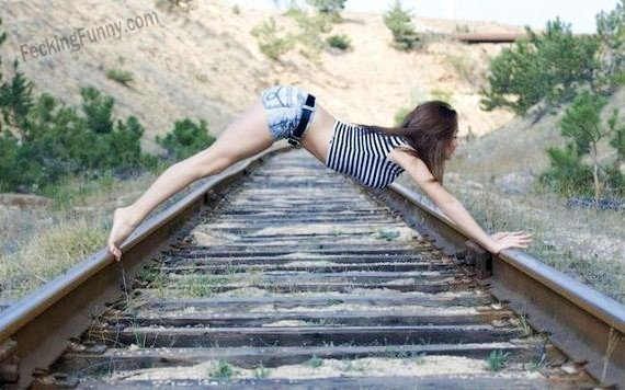 Woman posing on railroad