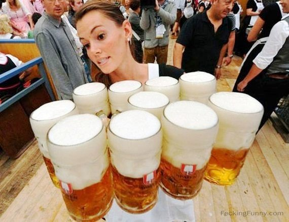 Woman holding 10 jars of beer