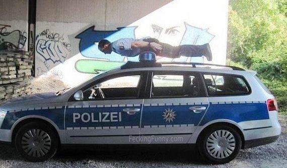 arrested-man-on-police-car-top