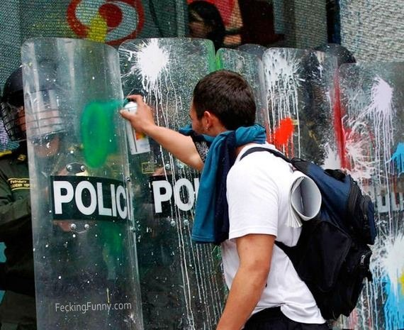 funny-protester-attacking-police-with-paint