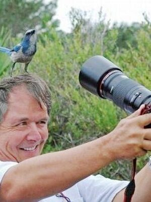 Self-shot: photographer with bird on head