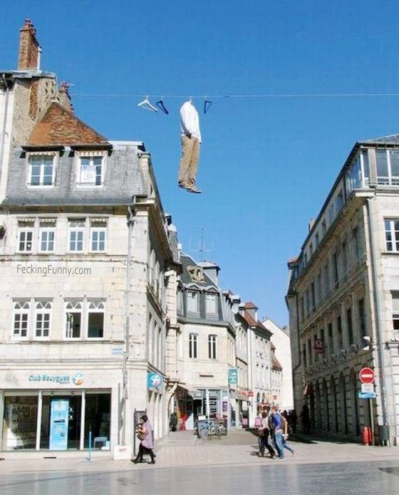 Hanging clothes between two buildings