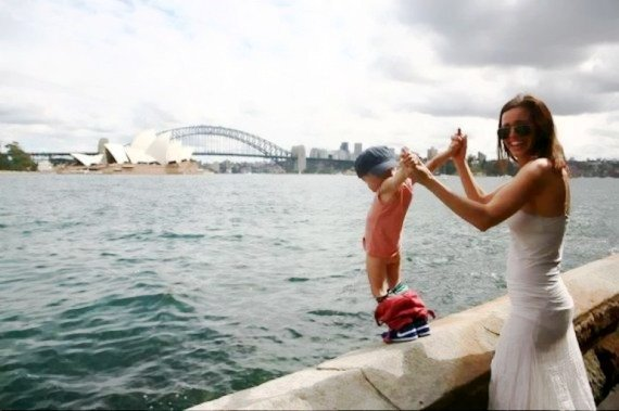 Peeing to river: kid and mother