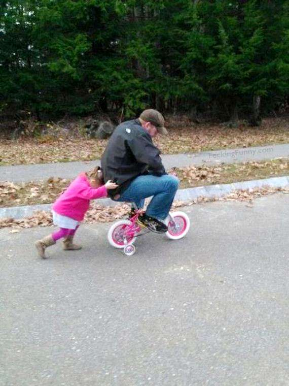 funny-daddy-riding-baby-bicycle