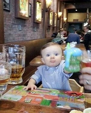 Funny baby toasting