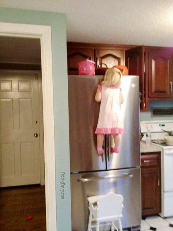 funny-girl-climbing-refrigerator