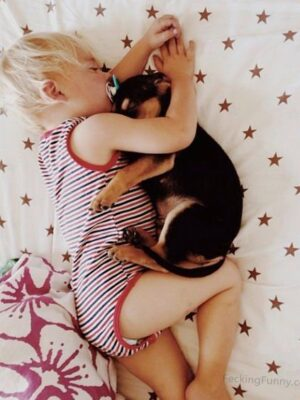 Funny baby sleeping with dog