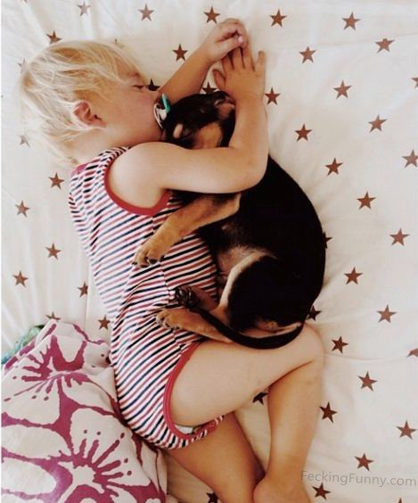 funny-kid-sleeping-with-dog