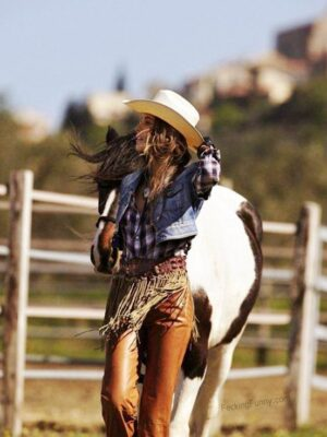 Sexy cowgirl with her horse