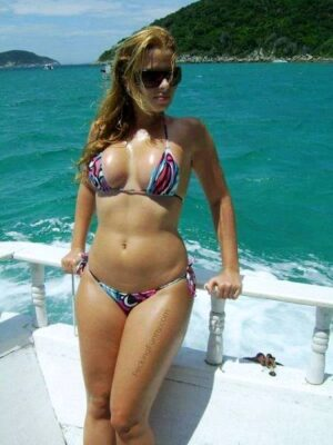 Beautiful bikini girl on boat