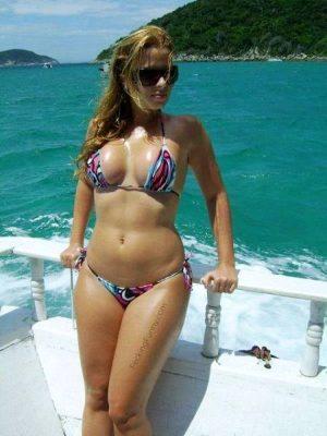 Beautiful bikini girl on boat