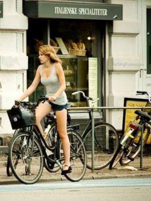 Busty girl on bike